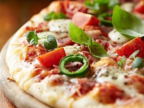 A delicious Pizza and Soda